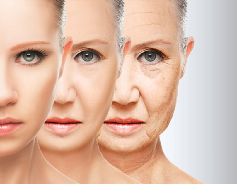 three womens faces with different aging